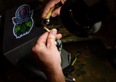 William Greene Fine Jewelry Design - Hands setting emerald in ring